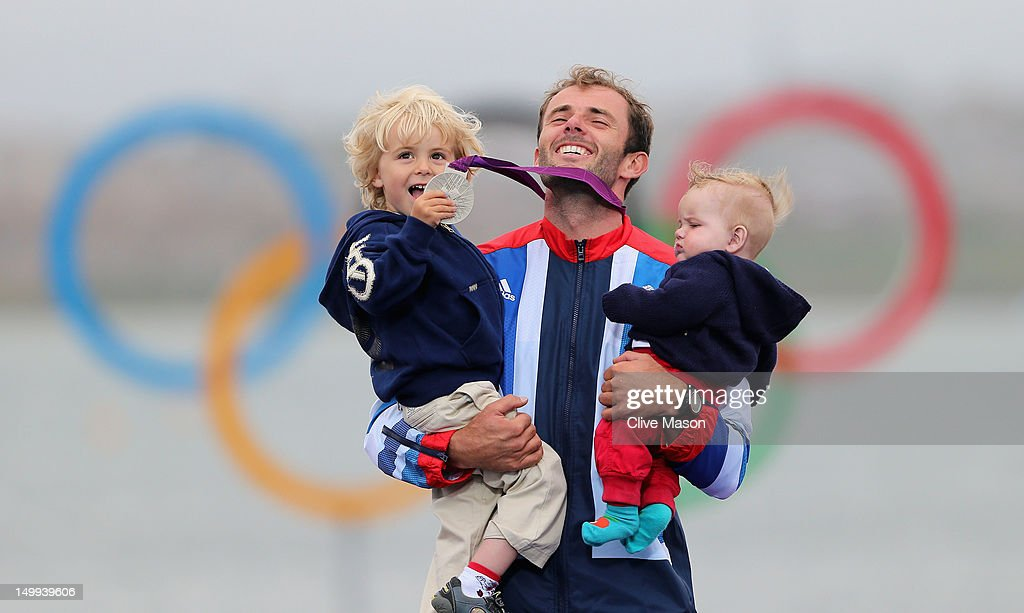 Silver medallist Nick Dempsey of Great Britain celebrates his children Thomas-Flynn (L) and Oscar (R) following the Men's