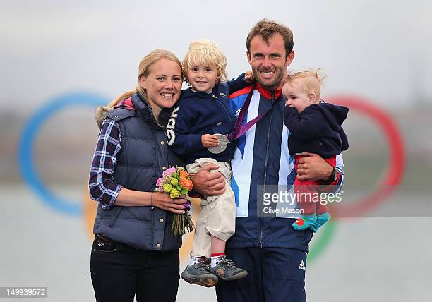 Silver medallist Nick Dempsey of Great Britain celebrates his wife Sarah and their children ThomasFlynn and Oscar following the Men's RSX Sailing on...