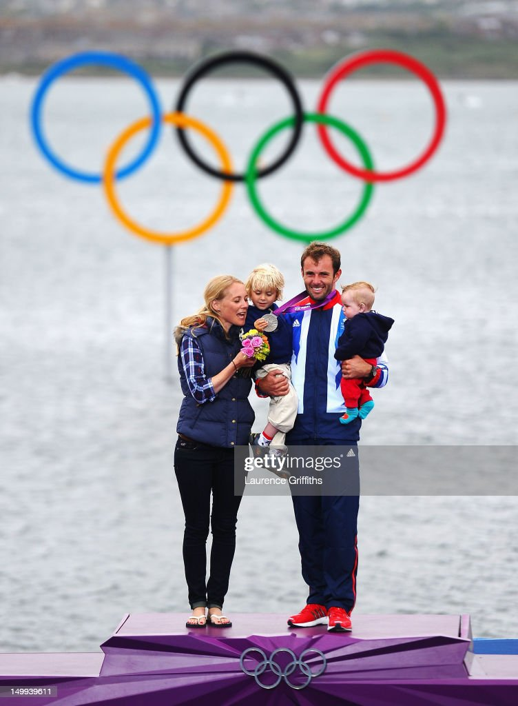Silver medallist Nick Dempsey of Great Britain celebrates his wife Sarah and their children Thomas-Flynn (C) and Oscar (R) following the Men's