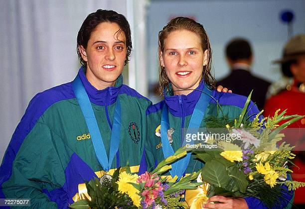 Silver medallist Nicole Stevenson and gold medallist Susie O'Neill of Australia celebrate after the Womens 200m Freestyle during the 1994...