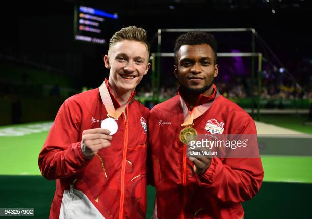 Silver medallist Nile Wilson of England and gold medallist Courtney Tulloch of England pose following the Gymnastics Men's Rings Final on day four of...