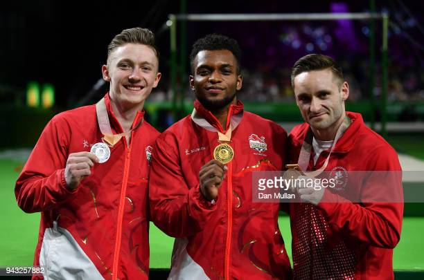 Silver medallist Nile Wilson of England gold medallist Courtney Tulloch of England and bronze medallist Scott Morgan of Canada pose following the...