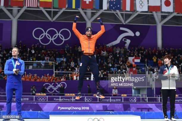 TOPSHOT Silver medallist Norway's Haavard Lorentzen gold medallist Netherlands' Kjeld Nuis and bronze medallist South Korea's Kim TaeYun celebrate on...
