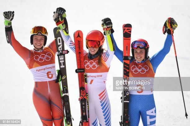 TOPSHOT Silver medallist Norway's Ragnhild Mowinckel gold medallist USA's Mikaela Shiffrin and bronze medallist Italy's Federica Brignone celebrate...