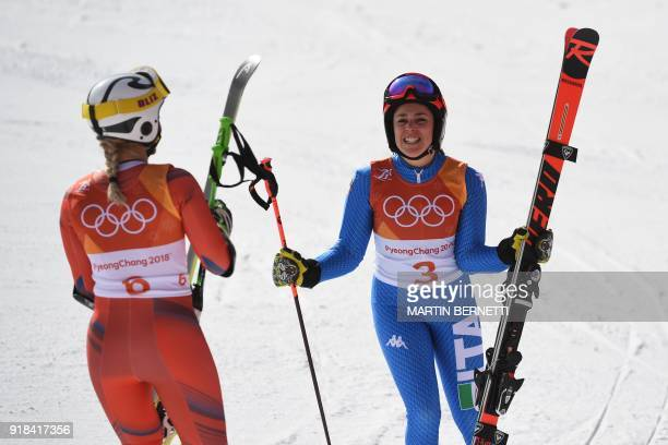 TOPSHOT Silver medallist Norway's Ragnhild Mowinckel reacts as Italy's Federica Brignone wins bronze at the finish line in the Women's Giant Slalom...