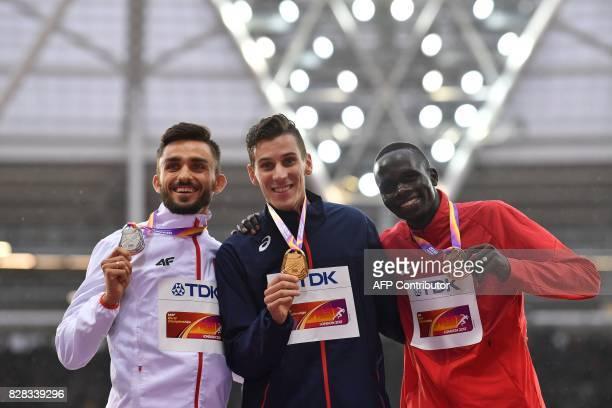 Silver medallist Poland's Adam Kszczot , gold medallist France's Pierre-Ambroise Bosse and bronze medallist Kenya's Kipyegon Bett pose on the podium...