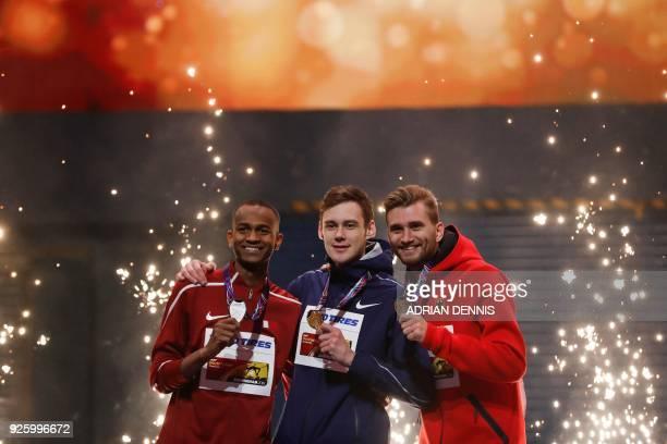 Silver medallist Qatar's Mutaz Essa Barshim gold medallist Authorised Neutral Athlete Danil Lysenko and bronze medallist Germany's Mateusz Przybylko...