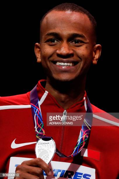 Silver medallist Qatar's Mutaz Essa Barshim poses on the podium during the medal ceremony for the men's high jump at the 2018 IAAF World Indoor...