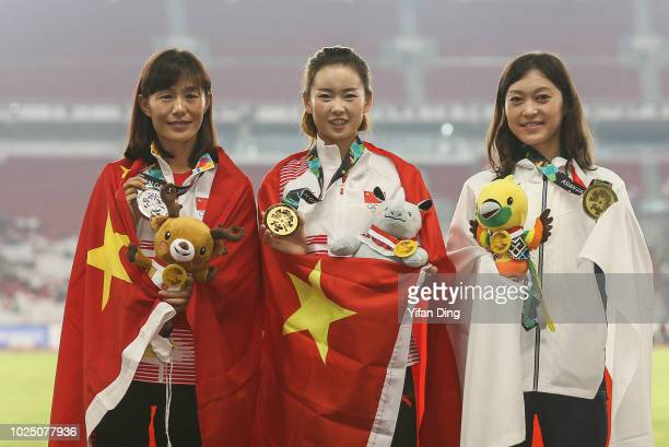 Silver medallist Qieyang Shijie of China gold medallist Yang Jiayu of China and bronze medallist Okada Kumiko of Japan pose for photo during...