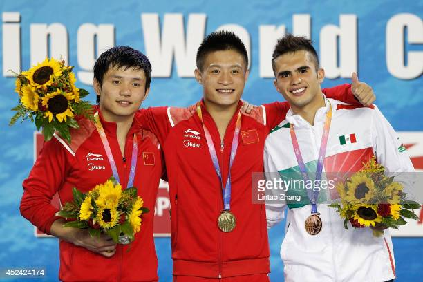 Silver medallist Qiu Bo and gold medallist Yang Jian of China with bronze medallist Ivan Garcia of Mexico celebrate during the medal ceremony for the...