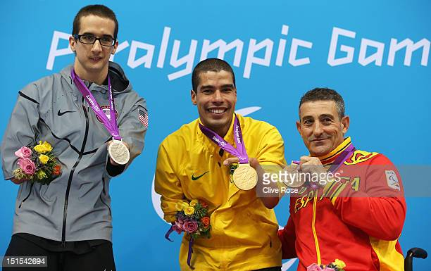 Silver medallist Roy Perkins of the United States gold medallist Daniel Dias of Brazil and bronze medallist Sebastian Rodriguez of Spain pose on the...