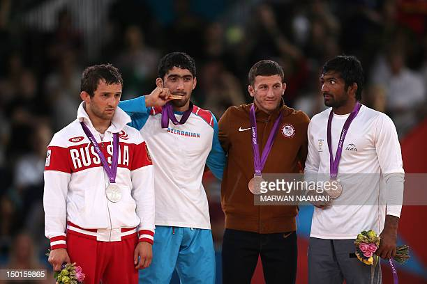 Silver medallist Russia's Besik Kudukhov gold medallist Azerbaijan's Toghrul Asgarov and bronze medallists US' Coleman Scott and India's Yogeshwar...