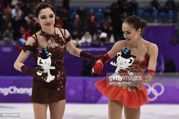 Silver medallist Russia's Evgenia Medvedeva and gold medallist Russia's Alina Zagitova attend the venue ceremony after the women's single skating...