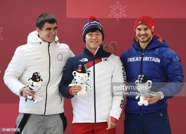 TOPSHOT Silver medallist Russia's Nikita Tregubov gold medallist South Korea's Yun Sungbin and bronze medallist Great Britain's Dom Parsons pose on...
