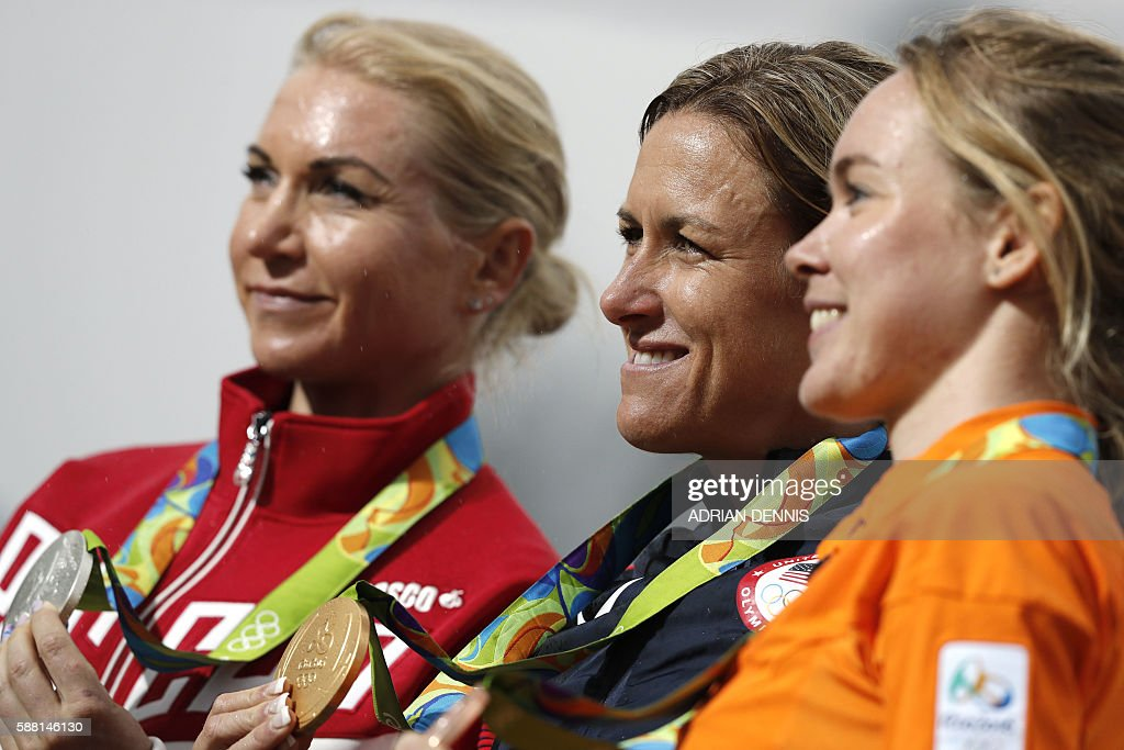 Silver medallist Russia's Olga Zabelinskaya, Gold medallist USA's Kristin Armstrong and Bronze medallist Netherlands Anna Van Der Breggen pose on the podium after the Women's Individual Time Trial event at the Rio 2016 Olympic Games in Rio de Janeiro on August 10, 2016. / AFP / Adrian DENNIS