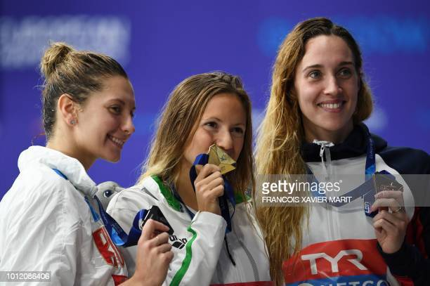 Silver medallist Russia's Svetlana Chimrova gold medallist Hungary's Boglarka Kapas and bronze medallist Britain's Alys Thomas pose on the podium...