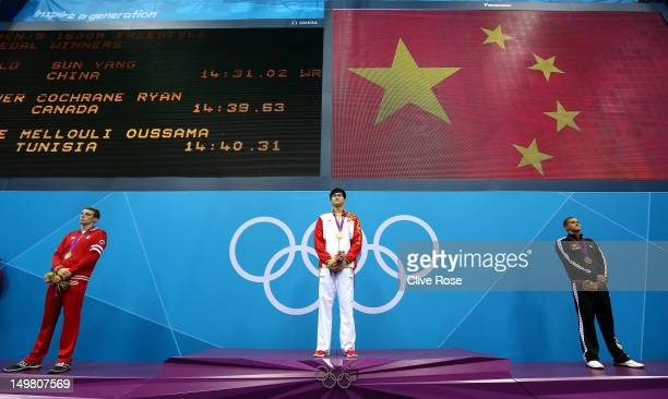Silver medallist Ryan Cochrane of Canada gold medallist Yang Sun of China and bronze medallist Oussama Mellouli of Tunisia pose on the podium during...