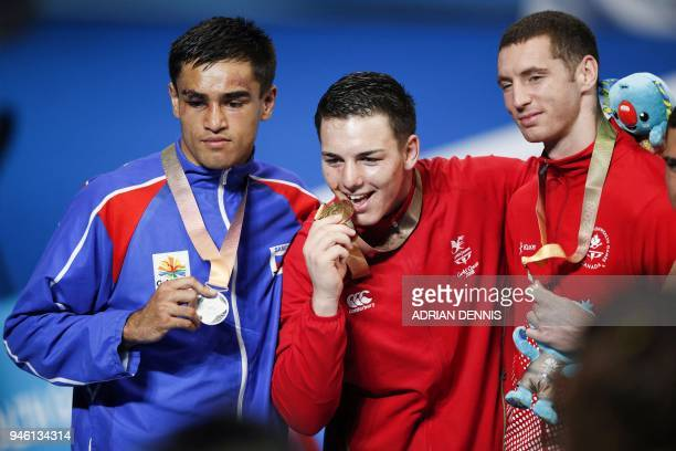 Silver medallist Samoa's Ato PlodzickiFaoagali gold medallist Wales' Sammy Lee and bronze medallist Canada's Harley O'Reilly attend the medal...