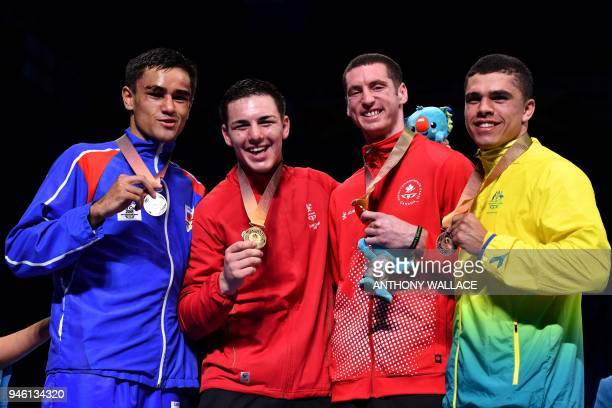 Silver medallist Samoa's Ato PlodzickiFaoagali gold medallist Wales' Sammy Lee and bronze medallists Canada's Harley O'Reilly and Australia's Clay...