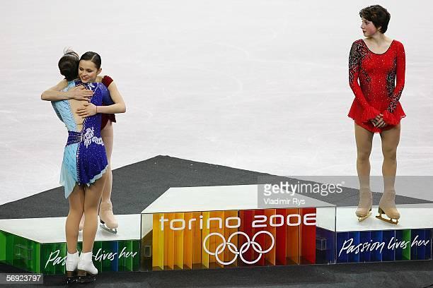 Silver medallist Sasha Cohen of the United State congratulates gold medal winner Shizuka Arakawa of Japanand Irina Slutskaya of Russia bronze medal...