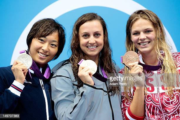 Silver medallist Satomi Suzuki of Japan gold medallist Rebecca Soni of the United States and bronze medallist Iuliia Efimova of Russia pose on the...