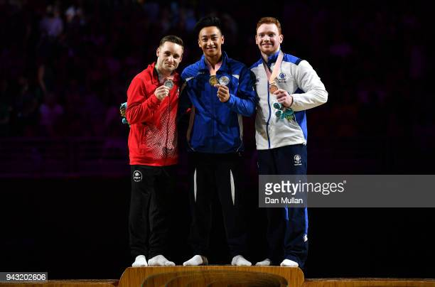 Silver medallist Scott Morgan of Canada gold medallist Marios Georgiou of Cyprus and bronze medallist Daniel Purvis of Scotland pose on the podium...