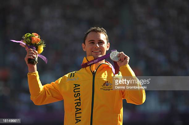 Silver medallist Scott Reardon of Australia poses on the podium during the medal ceremony for the Men's 100m T42 Final on day 10 of the London 2012...