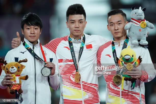 Silver medallist Shogo Nonomura of Japan, gold medallist Lin Chaopan and bronze medallist Xiao Ruoteng of China celebrate during the victory ceremony...