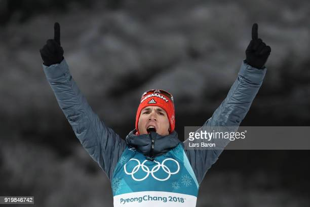 Silver medallist Simon Schempp of Germany celebrates during the victory ceremony for the Men's 15km Mass Start Biathlon on day nine of the...