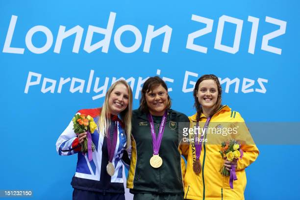 Silver medallist Stephanie Millward of Great Britain gold medallist Natalie du Toit of South Africa and bronze medallist Ellie Cole of Australia pose...