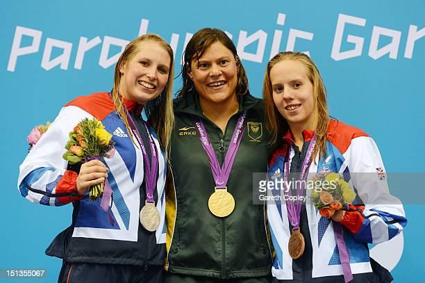 Silver medallist Stephanie Millward of Great Britain gold medallist Natalie du Toit of South Africa and bronze medallist Louise Watkin of Great...
