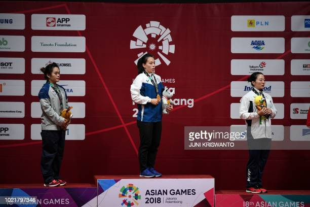 Silver medallist Sukanya Srisurat of Thailand gold medallist Kuo Hsingchun of Taiwan and bronze medallist Mikiko Andoh of Japan attend the victory...
