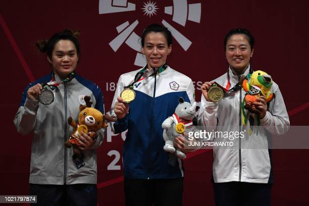 Silver medallist Sukanya Srisurat of Thailand gold medallist Kuo Hsingchun of Taiwan and bronze medallist Mikiko Andoh of Japan celebrate during the...