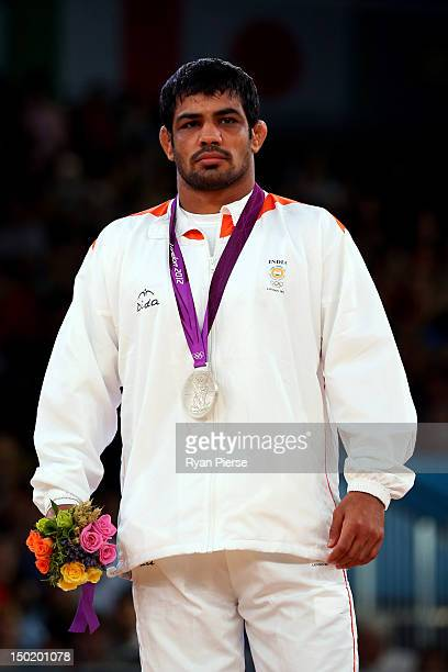 Silver medallist Sushil Kumar of India celebrates with his medal during the medal ceremony following the Men's Freestyle 66 kg Wrestling gold medal...