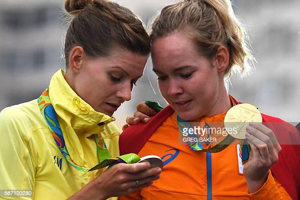 Silver medallist Sweden's Emma Johansson and Gold medallist Netherlands' Anna Van Der Breggen pose on the podium after the Women's road cycling race...