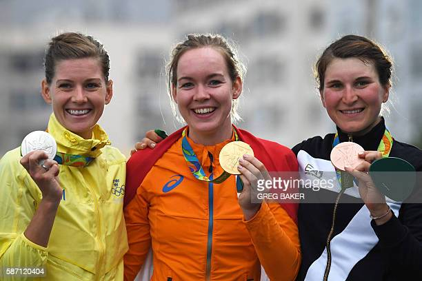 Silver medallist Sweden's Emma Johansson Gold medallist Netherlands' Anna Van Der Breggen and Bronze Italy's Elisa Longo Borghini pose on the podium...