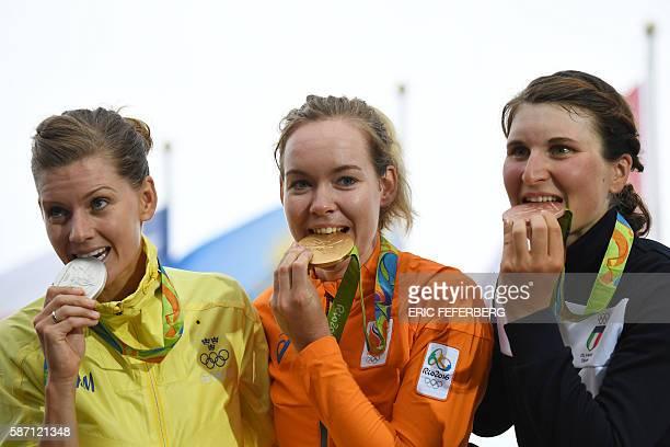 Silver medallist Sweden's Emma Johansson Gold medallist Netherlands' Anna Van Der Breggen and Bronze medallist Italy's Elisa Longo Borghini pose on...