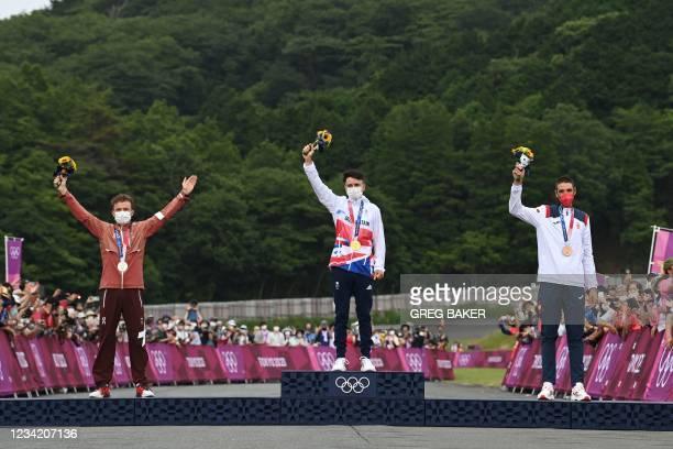 Silver medallist Switzerland's Mathias Flueckiger, gold medallist Britain's Thomas Pidcock and bronze medallist Spain's David Valero Serrano...