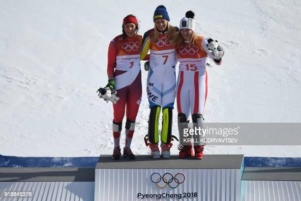 Silver medallist Switzerland's Wendy Holdener gold medallist Sweden's Frida Hansdotter and bronze medallist Austria's Katharina Gallhuber celebrate...