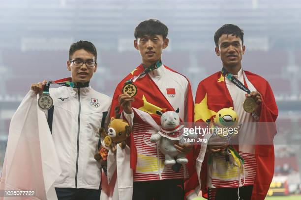 Silver medallist Toshikazu Yamanishi of Japan gold medallist Wang Kaihua of China and Bronze medallist Jin Xiangqian of China during Athletics MenÕs...