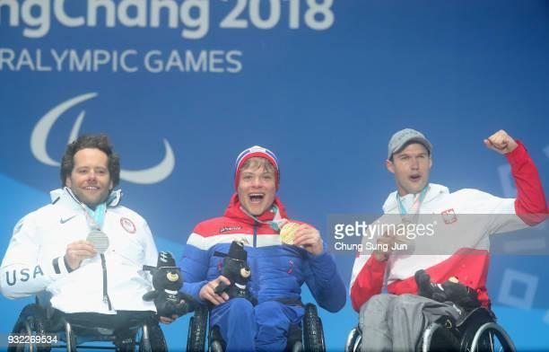 Silver medallist Tyler Walker of the United States Gold medallist Jesper Pedersen of Norway and Bronze medallist Igor Sikorski of Poland celebrate on...