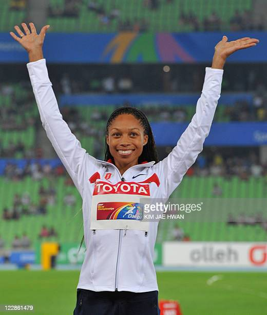 Silver medallist US athlete Allyson Felix waves during the awards ceremony for the women's 400 metres final at the International Association of...