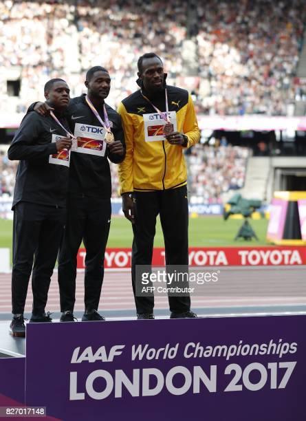 Silver medallist US athlete Christian Coleman gold medallist US athlete Justin Gatlin and bronze medallist Jamaica's Usain Bolt pose on the podium...