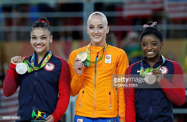 Silver medallist US gymnast Lauren Hernandez gold medallist Netherlands' Sanne Wevers and bronze medallist US gymnast Simone Biles pose on the podium...
