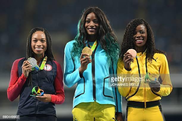Silver medallist USA's Allyson Felix gold medallist the Bahamas's Shaunae Miller and bronze medallist Jamaica's Shericka Jackson pose on the podium...