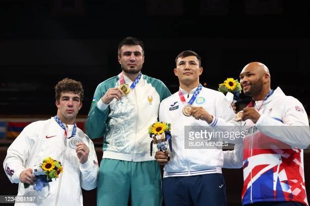 Silver medallist USA's Richard Torrez Jr, gold medallist Uzbekistan's Bakhodir Jalolov, bronze medallists Britain's Frazer Clarke and Kazakhstan's...