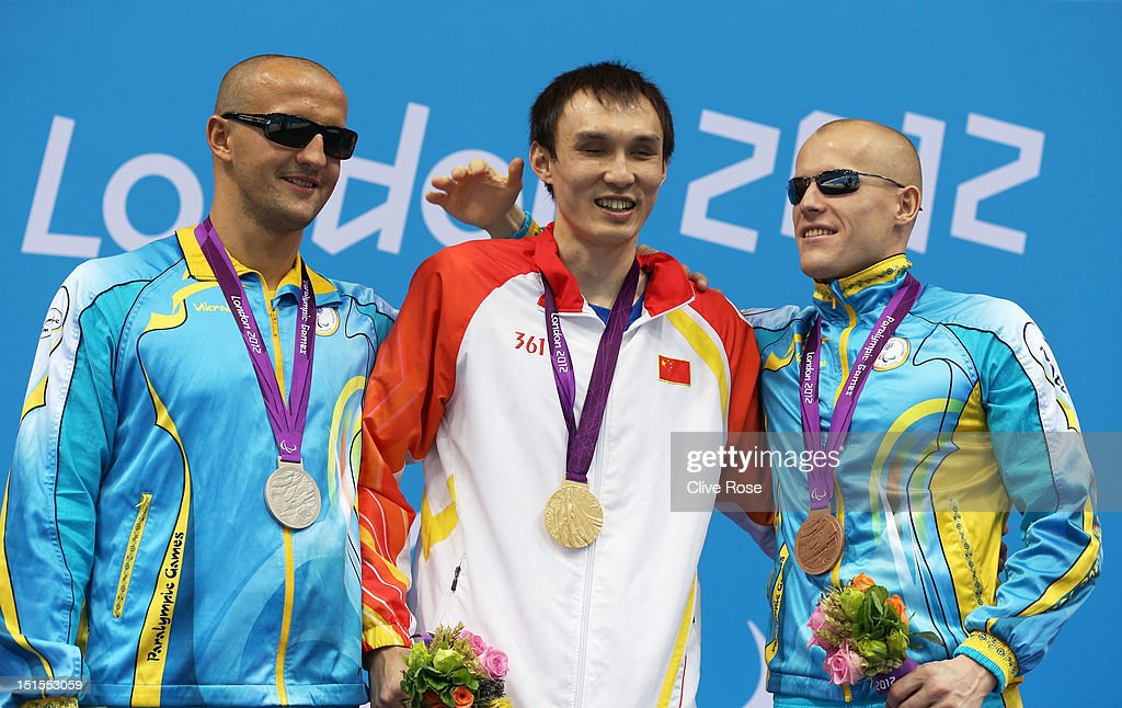 Silver medallist Viktor Smyrnov of Ukraine, gold medallist Bozun Yang of China and bronze medallist Oleksandr Maschenko of Ukraine pose on the podium during the medal ceremony for the Men's 200m Individual Medley -SM11 final on day 10 of the London 2012 Paralympic Games at Aquatics Centre on September 8, 2012 in London, England.