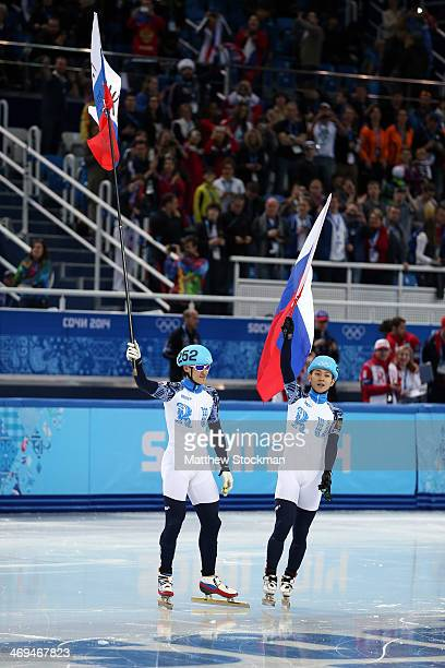 Silver medallist Vladimir Grigorev and gold medallist Victor An of Russia celebrate after the Men's 1000 m Final Short Track Speed Skating on day 8...