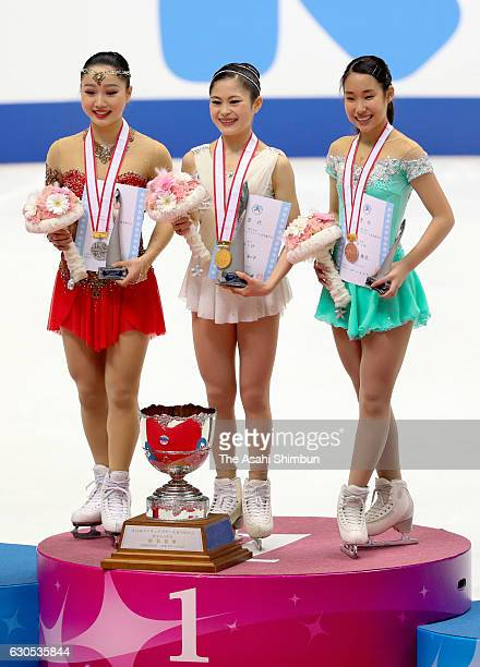 Silver medallist Wakaba Higuchi gold medalist Satoko Miyahara and bronze medalist Mai Mihara pose on the podium at the medal ceremony for the Women's...