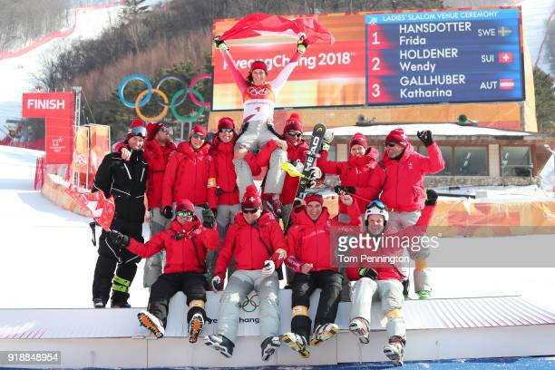 Silver medallist Wendy Holdener of Switzerland celebrates with her team during the victory ceremony for the Ladies' Slalom Alpine Skiing at Yongpyong...